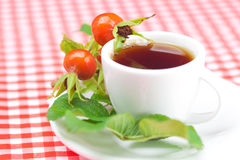 Cup of tea and rosehip Stock Image