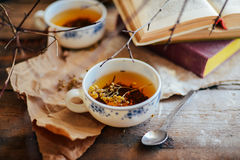 Cup of tea , rustic style.  cup of tea with spices and lemon on Stock Images