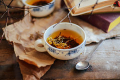 Cup of tea , rustic style.  cup of tea with spices and lemon on Stock Photo