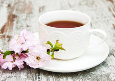 Cup of tea and sakura blossom Stock Photo