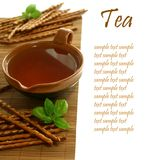 Cup of tea and salted sticks Royalty Free Stock Image