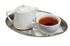 Cup of tea on a saucer. Isolated on a white background Stock Image
