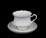 Cup of tea with a saucer on the black background Royalty Free Stock Images