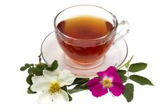 Cup of tea. On a saucer with dogrose flowers isolated on a white background Stock Photo