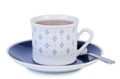 Cup tea on saucer with spoon. Royalty Free Stock Photo