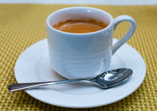 Cup of tea on saucer with a spoon Royalty Free Stock Photo