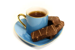 Cup with tea and a saucer with sweets Royalty Free Stock Photography