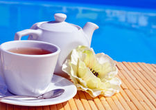 Cup of tea on a saucer and teapot Royalty Free Stock Photo