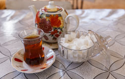 Cup of tea on the saucer, teapot and sugar bowl Royalty Free Stock Images