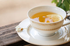 A cup of tea and a saucer on veranda Stock Photography