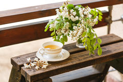A cup of tea and a saucer on veranda Stock Image