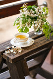 A cup of tea and a saucer on veranda Royalty Free Stock Photos