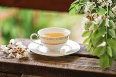 A cup of tea and a saucer on veranda Stock Photos