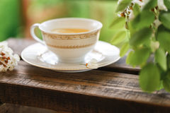 A cup of tea and a saucer on veranda Stock Photo
