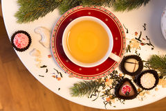 Cup of tea served with chocolate for Christmas Stock Photos