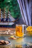 Cup of tea with ship inside concept sea ill lemon ginger cookies royalty free stock photos