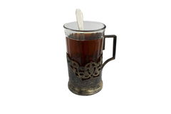 A cup of tea in silver cup holder Royalty Free Stock Images