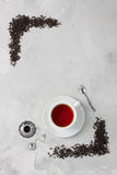 Cup of tea silver spoon little teapot on concrete background. Royalty Free Stock Image
