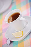 Cup of tea and a slice of lemon. A view of a cup of tea and a slice of lemon Royalty Free Stock Image