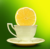 A cup of tea with a slice of lemon. Background for poster Stock Photo