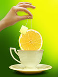 A cup of tea with a slice of lemon. Background for poster Royalty Free Stock Image