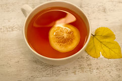 Cup of tea with a slice of lemon Stock Photo