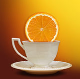 A cup of tea with a slice of orange. Background for poster Stock Images