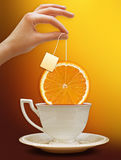 A cup of tea with a slice of orange. Background for poster Stock Photos