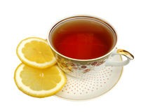 A cup of tea and slices of lemon Stock Images