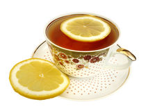 A cup of tea and slices of lemon Stock Image