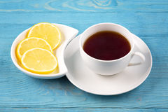 In a cup of tea and slices of lemon Royalty Free Stock Photo