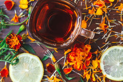 Cup of tea with slices of lemon and flowers Stock Image