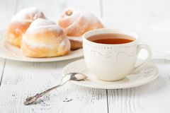 Cup of tea and small apple roses shaped pies. Sweet apple dessert pie Stock Photography