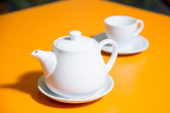 Cup of tea snd teapot Stock Images