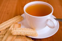 Cup of tea and some cookies. On wooden table royalty free stock images