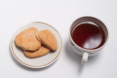 Cup of tea and some cookies. On white background royalty free stock photos