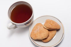 Cup of tea and some cookies. On white background royalty free stock photography
