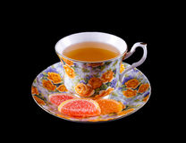 Cup of tea and some marmalade. On the saucer Stock Image