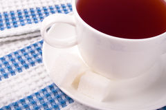 Cup of tea and some sugar Stock Image