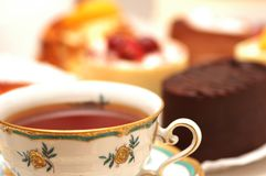 Cup of tea and some sweets royalty free stock photo