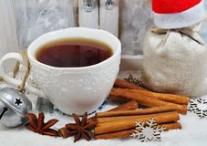 Cup of tea with spices in winter - Christmas time Royalty Free Stock Image