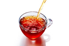 Cup of tea with splash isolated. On the white background Royalty Free Stock Photography