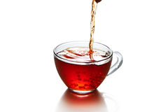 Cup of tea with splash isolated. On the white background Stock Images