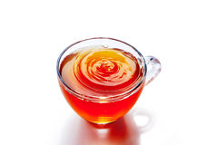Cup of tea with splash. On the white background stock photography