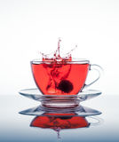 Cup of tea with splashes Royalty Free Stock Image