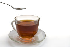 Cup of tea and a spoon Stock Photography