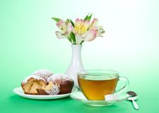 Cup with tea, spoon and cupcakes Royalty Free Stock Photo