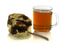 Cup of tea with a spoon and a piece of cake. On white background Stock Photography