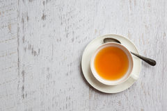 Cup of tea with spoon on white background Stock Photography