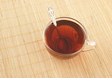 Cup of tea with spoon on wooden background Royalty Free Stock Photo